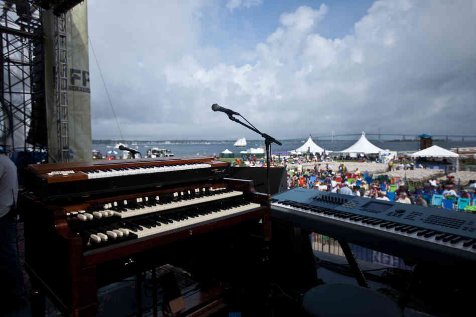 Preparations are underway on the main Fort Stage at the Newport Jazz Festival, overlooking the Pell Bridge and the pleasure craft of Narragansett Bay.