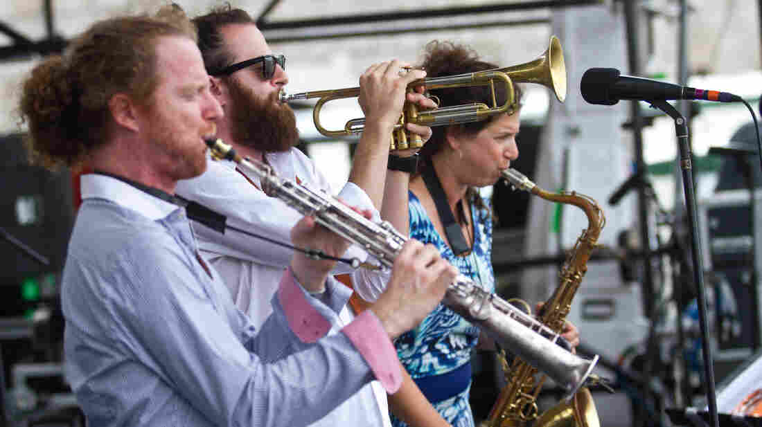 The Three Cohens — Anat (right), Avishai (trumpet, center) and Yuval (left) — perform at the 2012 Newport Jazz Festival.