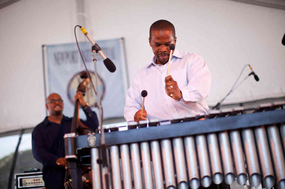 Vibraphonist Warren Wolf brought a crystalline resonance to bassist Christian McBride's band Inside Straight. His bandleader looked on approvingly.
