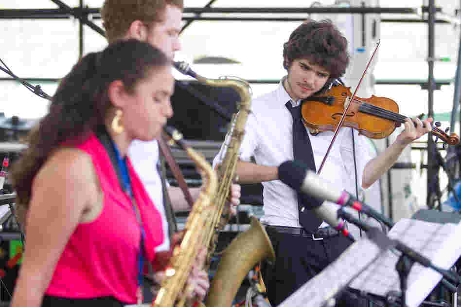 The Berklee Global Jazz Ambassadors feature students from around the world, including saxophonists Lihi Haruvi (left) and Matthew Halpin (center) and violinist Alex Hargreaves. Professional drummer Adam Cruz anchored their Fort Stage performance.