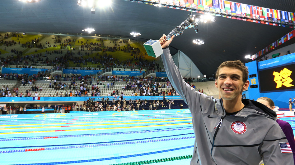 Michael Phelps and the special award he received Saturday night to mark his Olympic achievements. (Getty Images)