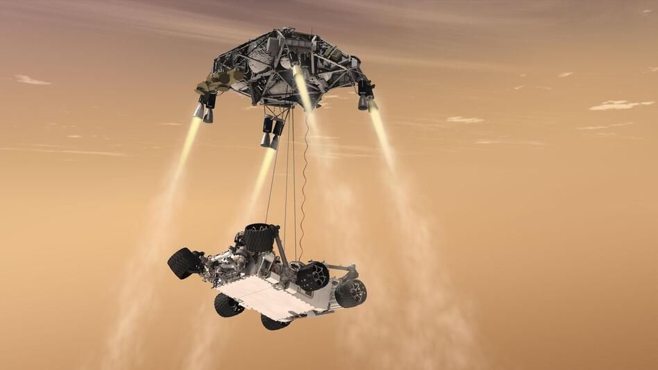 An artist's rendering shows a rocket-powered descent stage lowering the one-ton Curiosity rover to the Mars surface. (NASA/JPL-Caltech)