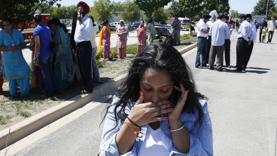 Anxiously waiting for word: Family and friends of those who were inside the Sikh temple gathered nearby as they waited for news about their loved ones. (AP)