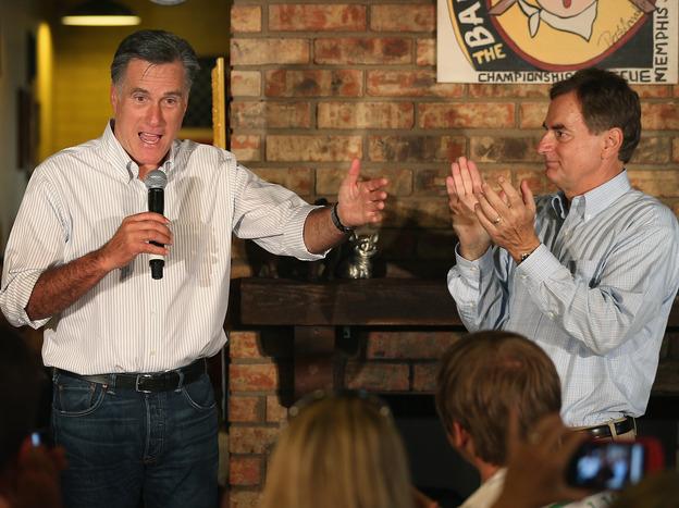 U.S. Senate candidate Richard Mourdock listens to Mitt Romney last week in Evansville, Ind.