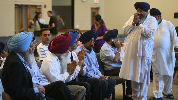 Members of the Milwaukee-area Sikh community gather Monday in Oak Creek, Wis., to learn more information about a shooting spree that left six people dead. Sikhs have faced a number of attacks in the U.S. in recent years. (Getty Images)