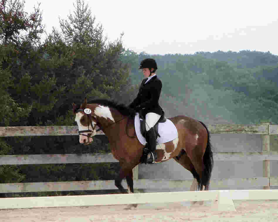 College student Celia Rozanski rides Jasper at a horse show sponsored by the Potomac Valley Dressage Association.