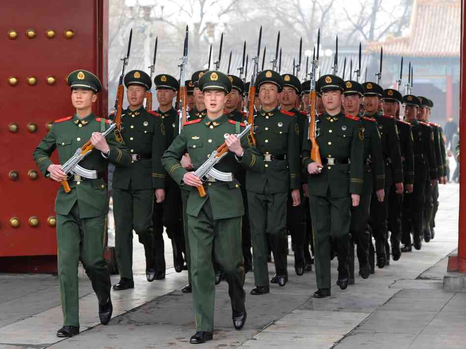 Chinese Paramilitary soldiers train outside their barracks in Beijing on March 19. Military spending in Asia will top that in Europe for the first time this year, the International Institute for Strategic Studies (IISS) said in its annual assessment of the strength of the world's armies.