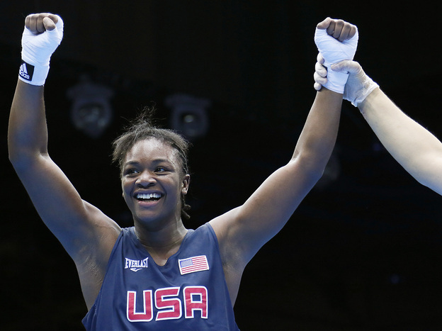 U.S. boxer Claressa Shields is declared the winner on points over Anna Laurell of Sweden in the women's middleweight boxing quarterfinals at the 2012 London Olympic Games.