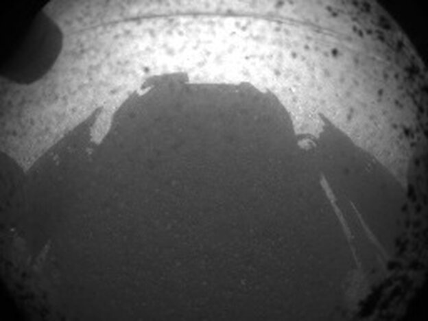 Curiosity's shadow on the surface of Mars, just minutes after the rover la