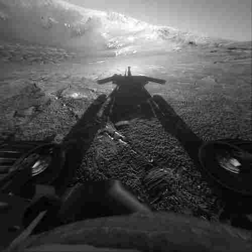 A snapshot of Opportunity's shadow was taken as the rover moved into Endurance Crater in 2004.
