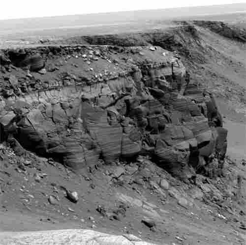Opportunity spent about 300 sols (Martian days) during 2006 and 2007 traversing the rim of Victoria Crater. Besides looking for a good place to enter the crater, the rover obtained images of rock outcrops exposed at several cliffs along the way.
