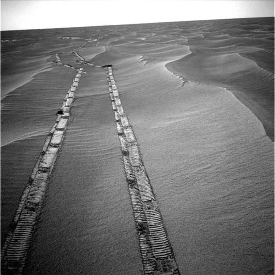 Opportunity used its navigation camera for this view of tracks the rover left on a drive from one end of a sand ripple to another, 2010.