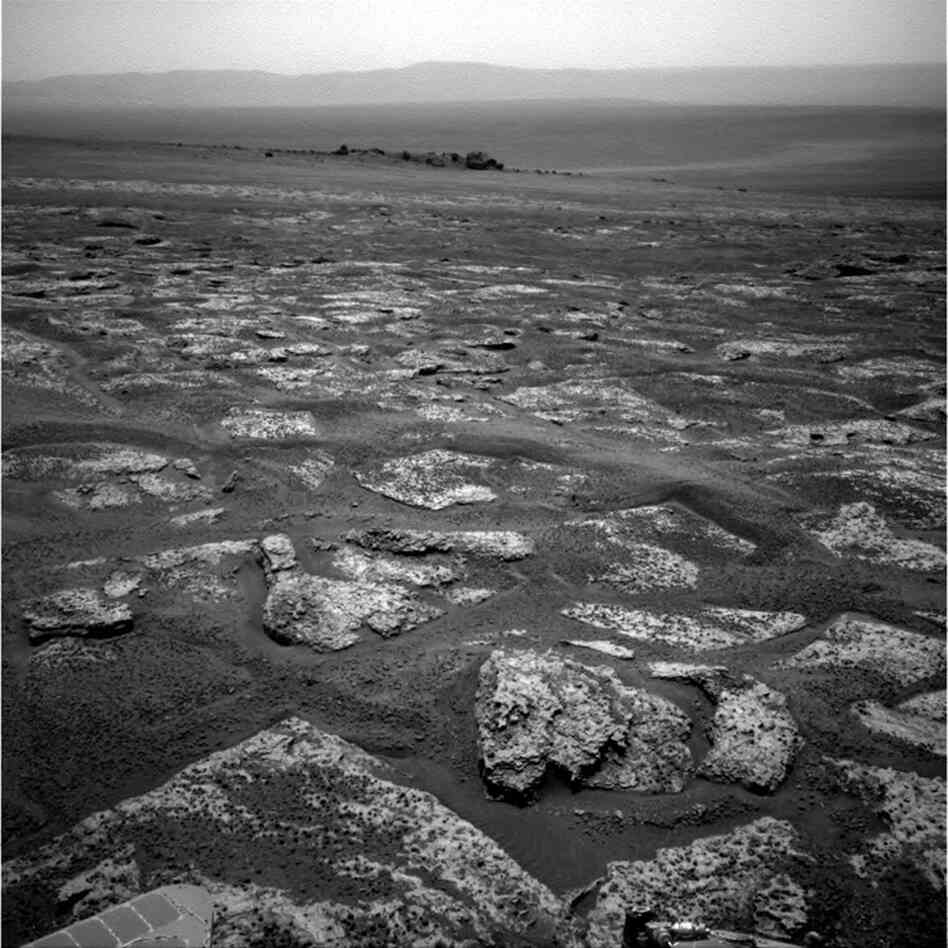 This image from Opportunity shows the view ahead on the day before the rover reached the rim of Endeavour crater. It was taken during the 2,680th sol of the rover's work on Mars.