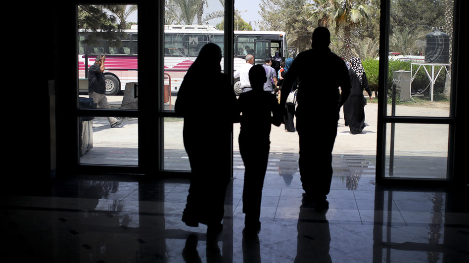 Days before Egypt shut down the Rafah border crossing, Palestinians were seen leaving the terminal to get on buses that would take them to Egypt. (Tara Todras-Whitehill for NPR)
