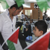 Palestinians look at items in a gift shop as they wait to cross into Egypt at the Rafah border crossing in the Gaza Strip last month. Egypt shut down the crossing less than a week later, after a deadly attack near Rafah left 16 Egyptian soldiers dead.