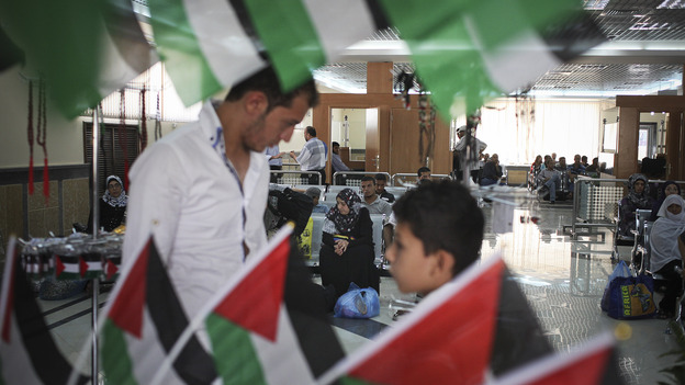 Palestinians look at items in a gift shop as they wait to cross into Egypt at the Rafah border crossing in the Gaza Strip last month. Egypt shut down the crossing less than a week later, after a deadly attack near Rafah left 16 Egyptian soldiers dead. (Tara Todras-Whitehill for NPR)