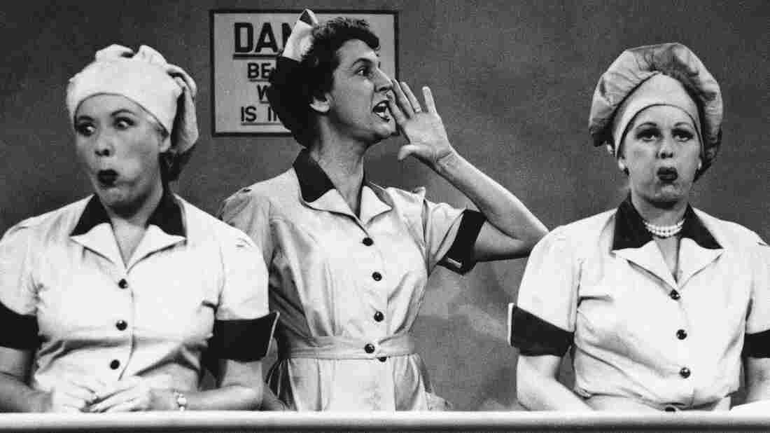 """Vivian Vance and Lucille Ball ham it up at the chocolate factory in a famous food-centric episode of """"I Love Lucy."""""""