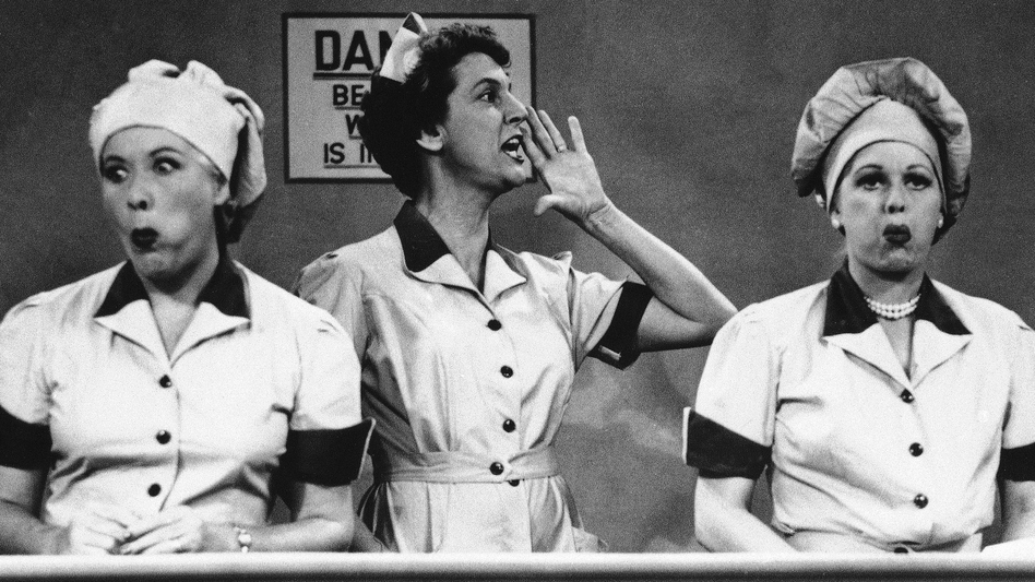 "Vivian Vance and Lucille Ball ham it up at the chocolate factory in a famous food-centric episode of ""I Love Lucy."""