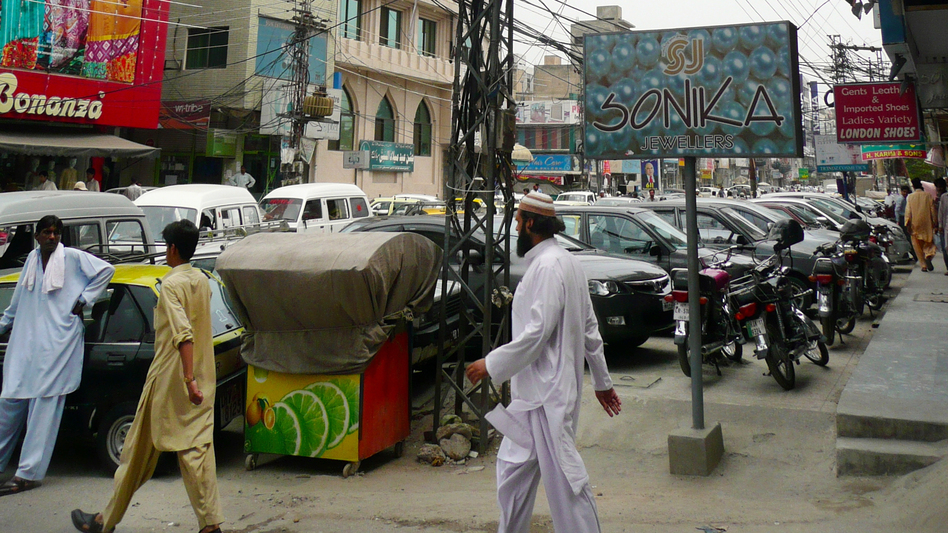 Tangled power lines in a busy shopping district in Rawalpindi. (Lauren Frayer for NPR)
