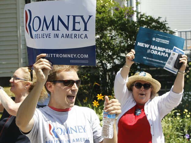 Supporters of President Obama shout as Republican presidential candidate Mitt Romney walks in the Fourth of July Parade in Wolfeboro, N.H.