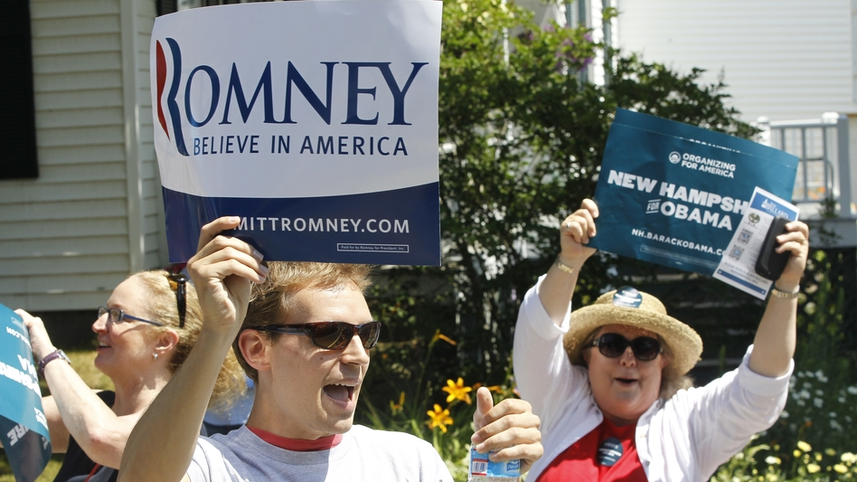Supporters of President Obama shout as Republican presidential candidate Mitt Romney walks in the Fourth of July Parade in Wolfeboro, N.H. (AP)