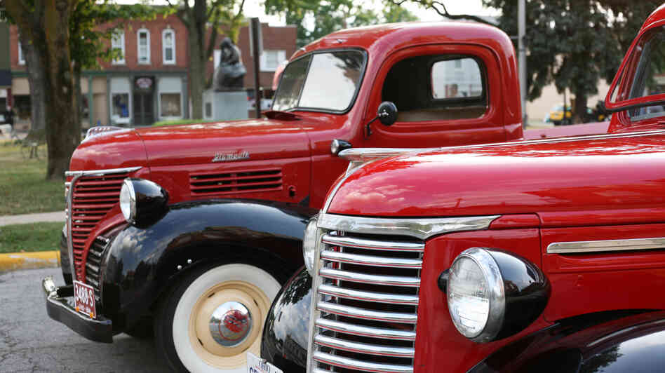 Antique trucks, including a 1937 Plymouth, on display at the weekly Cruisin' on the Square car show in Milan, Ohio. Classic car owners and enthusiasts gather each Tuesday evening through the summer to show off their cars or even find one to buy.