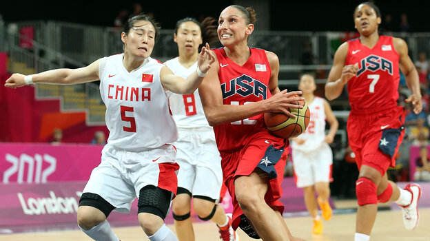 American Diana Taurasi drives to the basket past Xiaoyun Song #5 of China during their preliminary round match on Day 9 of the London 2012 Olympic Games.