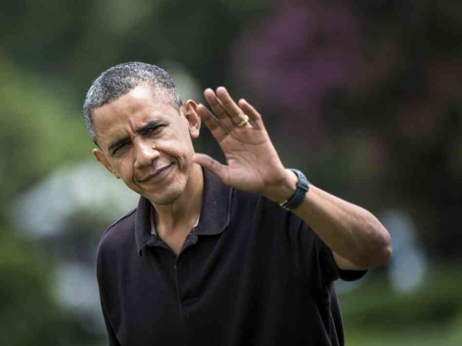 President Barack Obama waves while walking from Marine One to the Residence at the White House on August 5 in Washington, D.C.