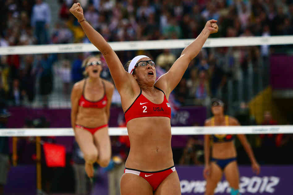 Misty May-Treanor of the U.S. celebrates at the end of the women's beach volleyball semifinal with Kerri Walsh Jennings (in the background) against China's Xue Chen and Zhang Xi. USA won 2-0.