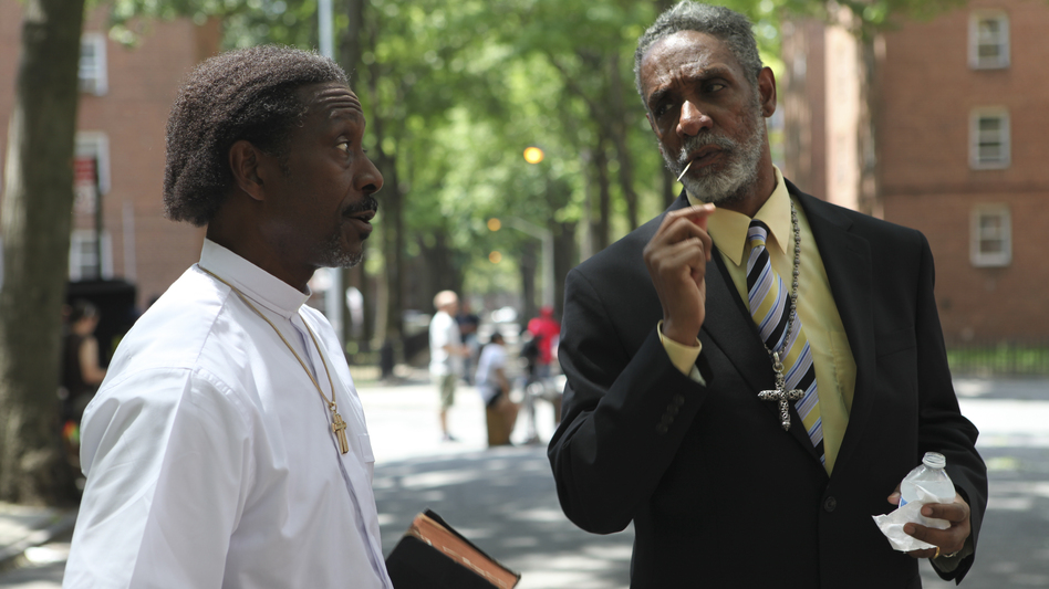 Enoch shares a word with Deacon Zee (Thomas Jefferson Byrd). Clarke Peters is powerful as Enoch and becomes the focus of the film as it goes on. (40 Acres and a Mule Filmworks)