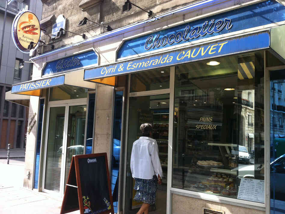 A woman walks into Boulangerie Cauvet in Paris, where they still make croissants from scratch.