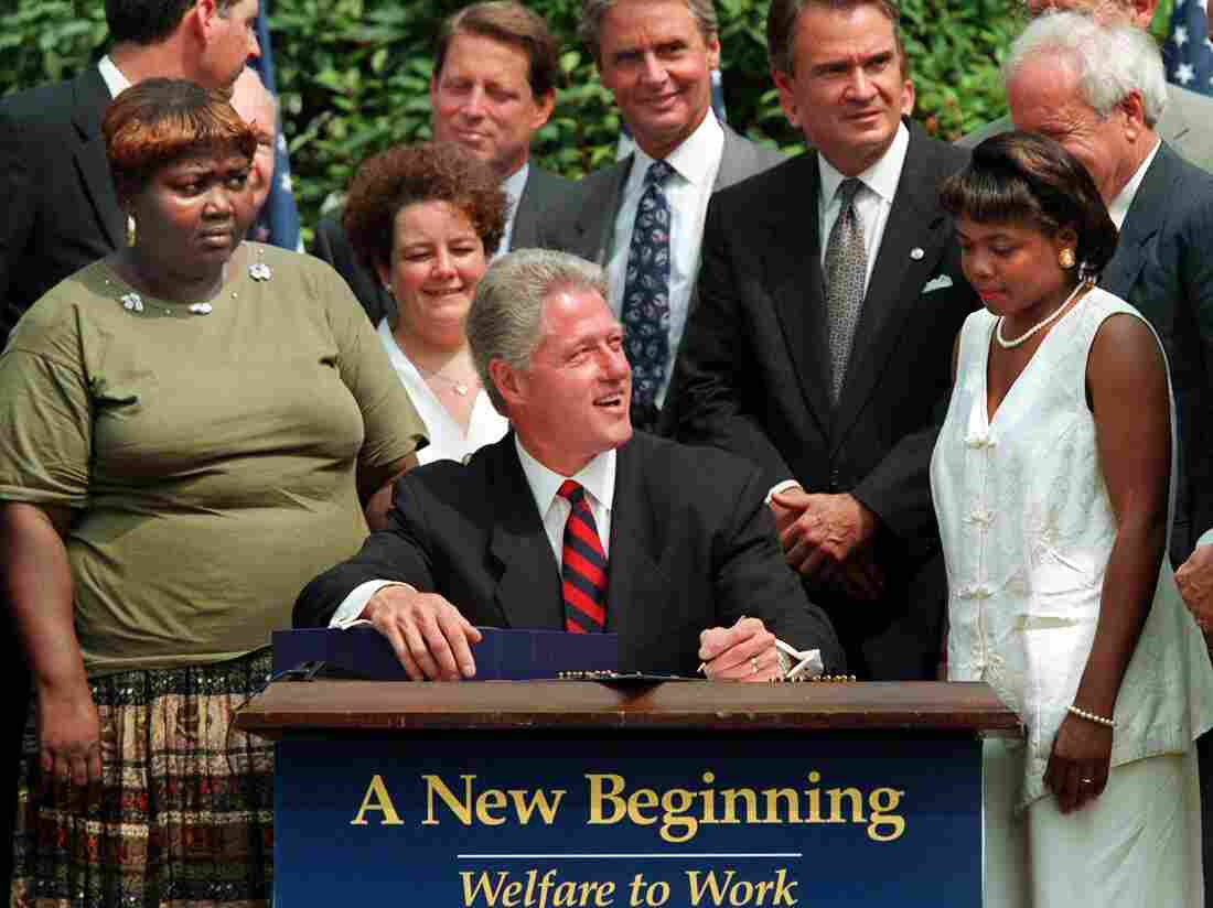 President Bill Clinton signs welfare reform legislation into law on Aug. 22, 1996.