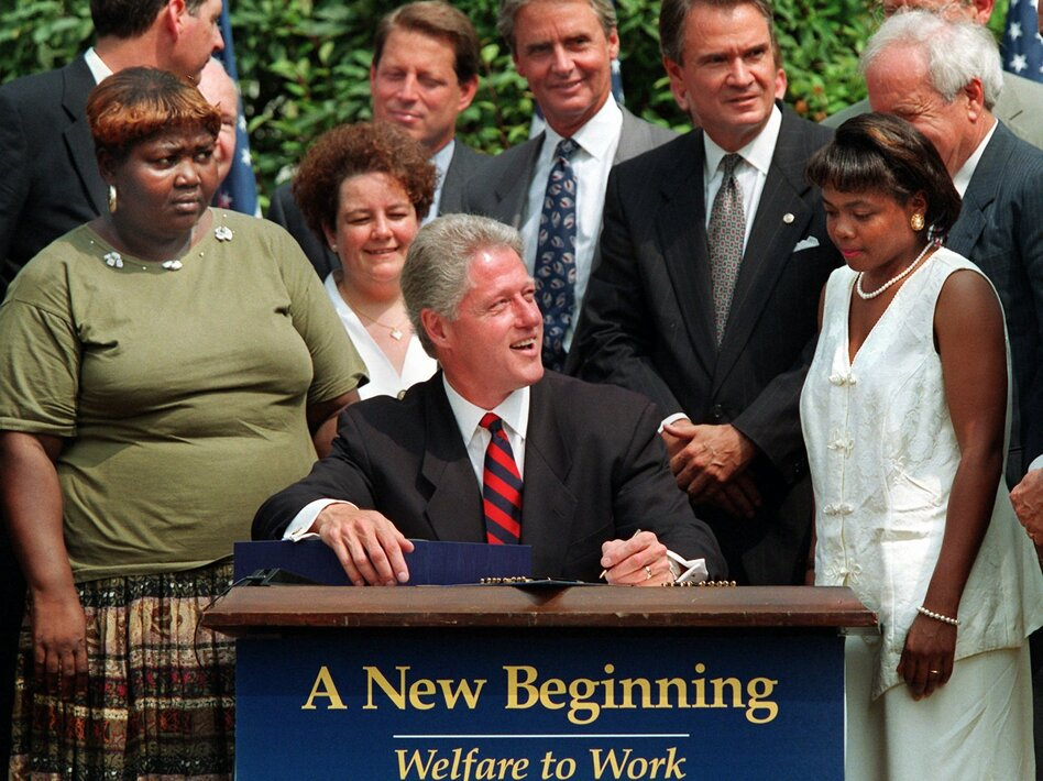 President Bill Clinton signs welfare reform legislation into law on Aug. 22, 1996. (AP)