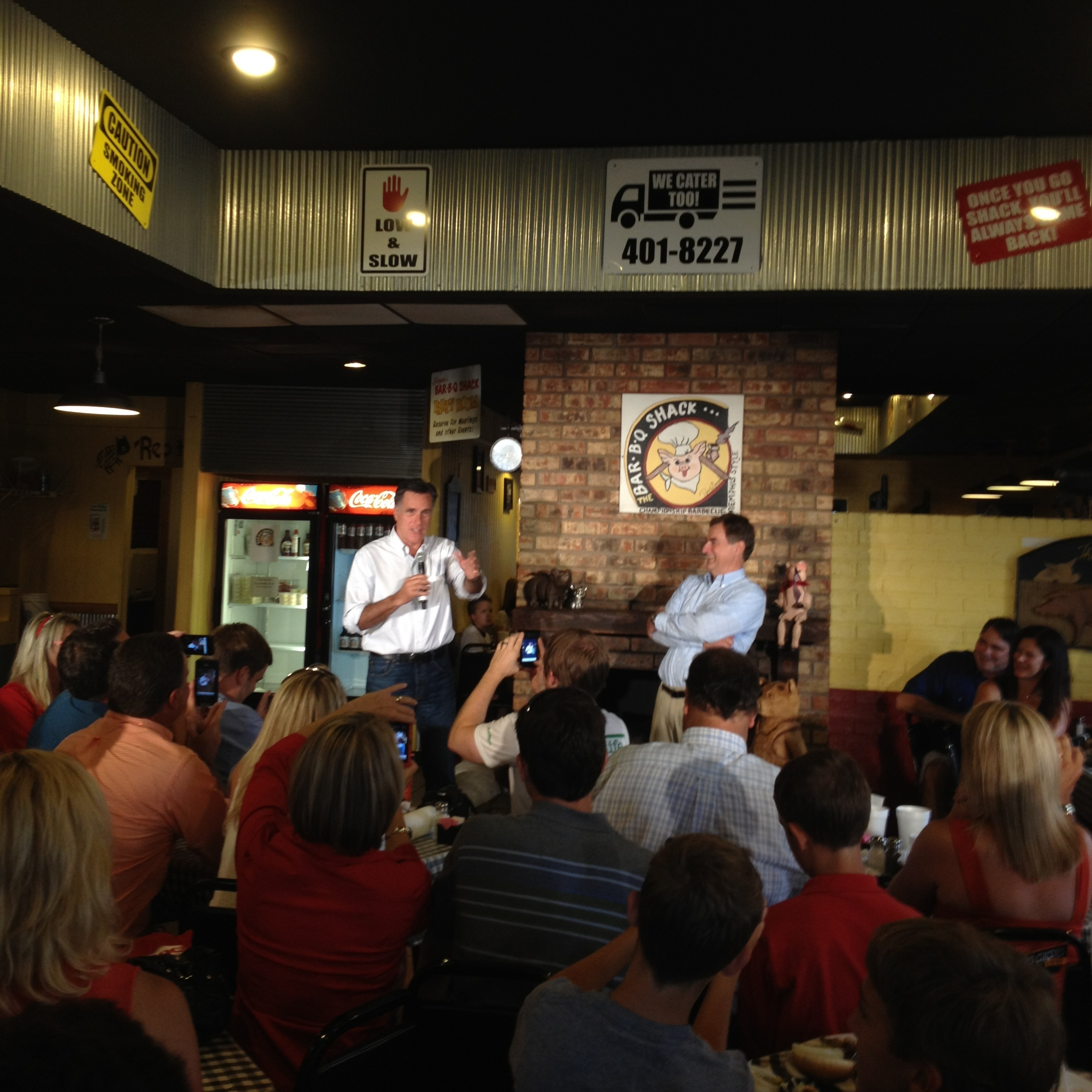 Romney speaks at Stepto's Bar-B-Q Shack on Saturday in Evansville, Ind., with U.S. Senate candidate Richard Mourdock (right).