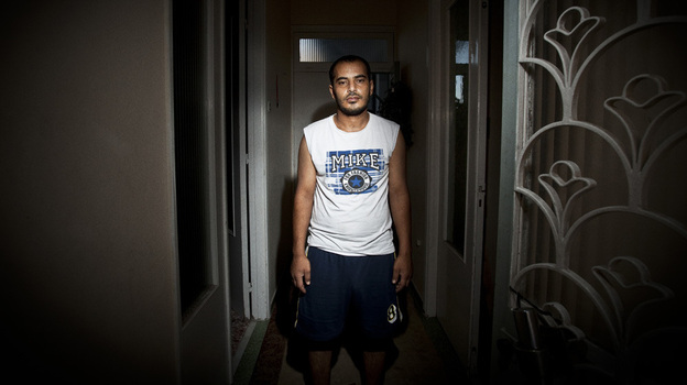 Abouzeid Mubarak, 28, arrived in Greece six months ago. But after being viciously assaulted, the father of three says he is thinking of returning home to Egypt. (Myrto Papadopoulos for NPR)