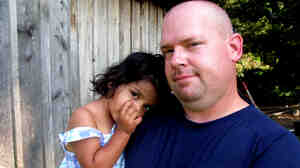Mike Cannata with 2-year-old Bella. Mike and his wife, Barb, brought Bella home from Bulgaria this past spring after spending five years attempting to adopt.
