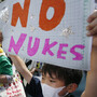 "Anti-nuclear protesters carry ""No nukes"" banners during a march in Tokyo last month. Protests against Japan's use of nuclear power have grown in the aftermath of the March 2011 Fukushima disaster."
