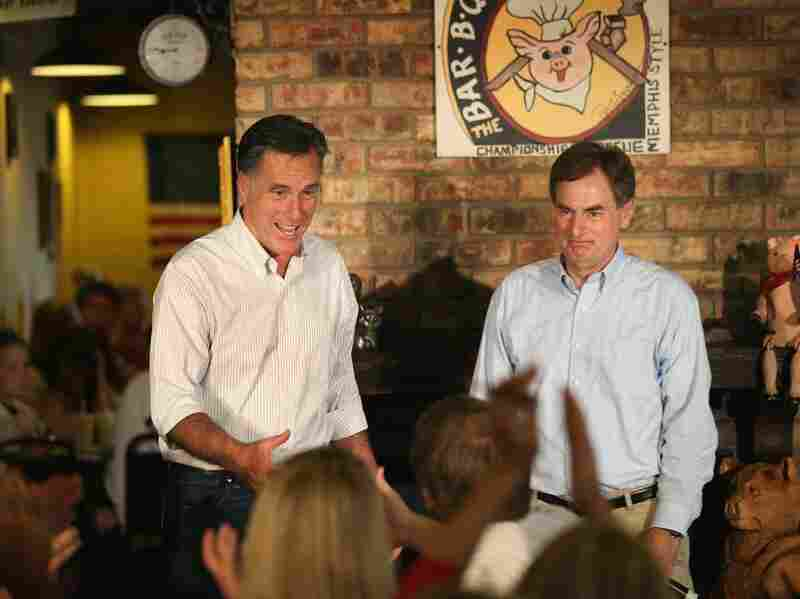 Republican presidential candidate Mitt Romney and Senate Candidate Richard Mourdock greet supporters at a campaign event at Stepto's Bar-B-Q Shack on August 4 in Evansville, Ind. Romney told supporters at the event that the latest jobs report was evidence that Obama's economic policies were not working.