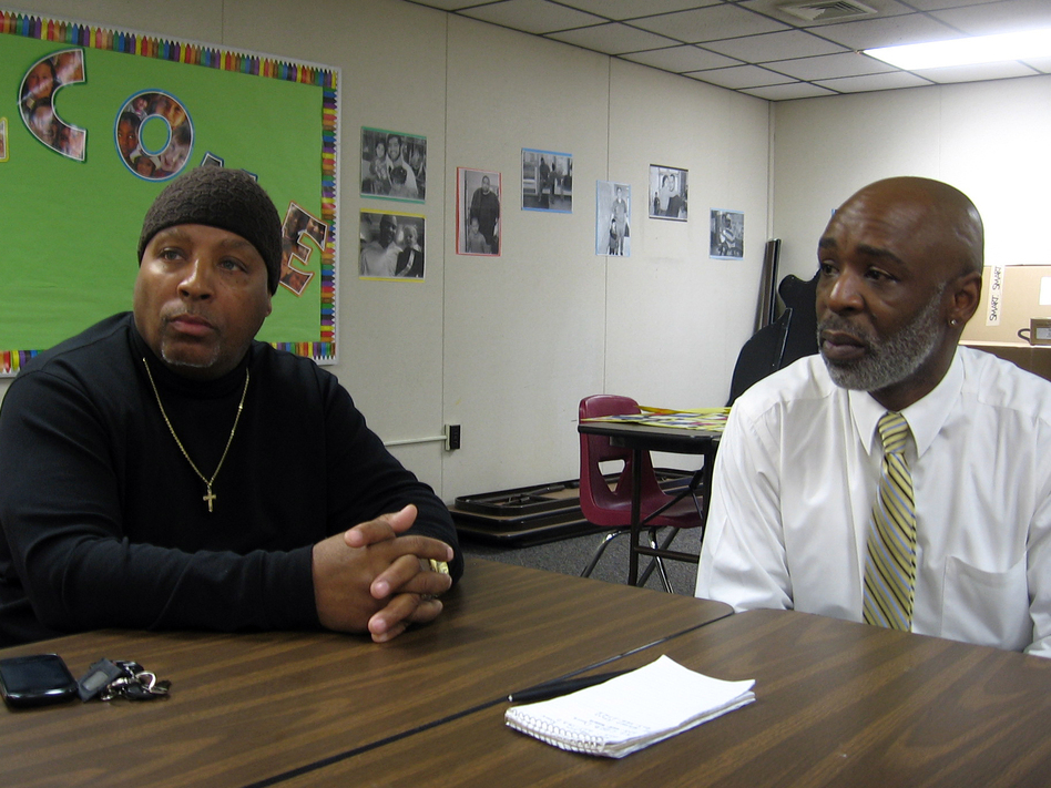 Rickie Knox (left) meets with Keith Young at New Haven's Head Start center. Knox comes here almost every day to be with his two grandchildren. (NPR)