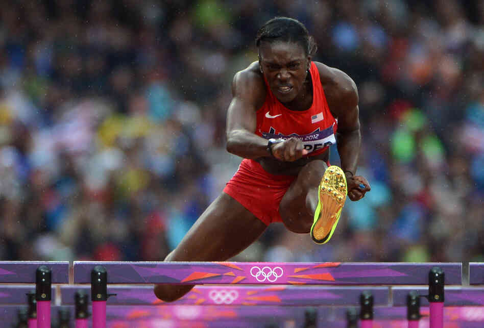 U.S. hurdler Dawn Harper competes in the women's 100-meter hurdles semifinals. She won a silver medal in the finals.