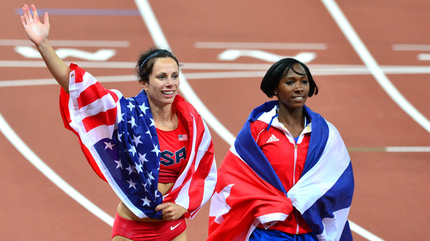 American gold medalist Jenn Suhr and Cuba's silver medalist Yarisley Silva celebrate after the women's pole vault final at the London 2012 Olympics. Suhr won silver at the 2008 Games. (AFP/Getty Images)