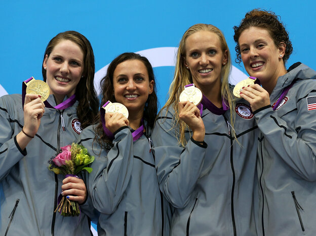 U.S. gold medallists pose on the podium after their world-record 4x100m medley relay final.