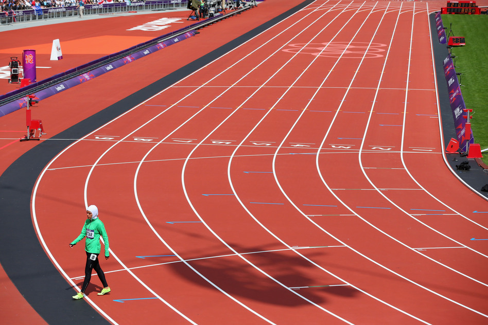 Sarah Attar of Saudi Arabia walks off the track after competing in the Women's 800m Round 1 Heats.