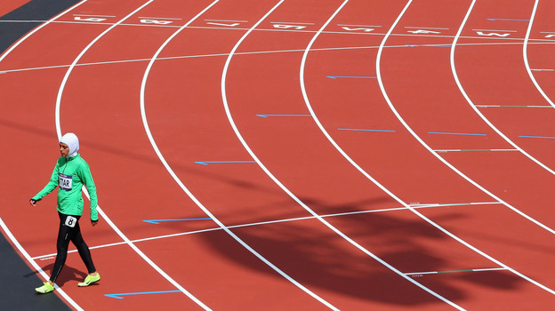 Sarah Attar of Saudi Arabia walks off the track after competing in the Women's 800m Round 1 Heats. (Getty Images)