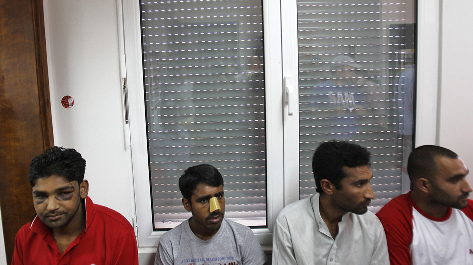 Immigrants at a news conference in Athens on June 21 say they were attacked by members of the extreme-right Golden Dawn party. United Against Racism and Fascist Violence Movement, an immigrants-support group, says Golden Dawn is behind attacks on hundreds of immigrants to Greece. (AP)