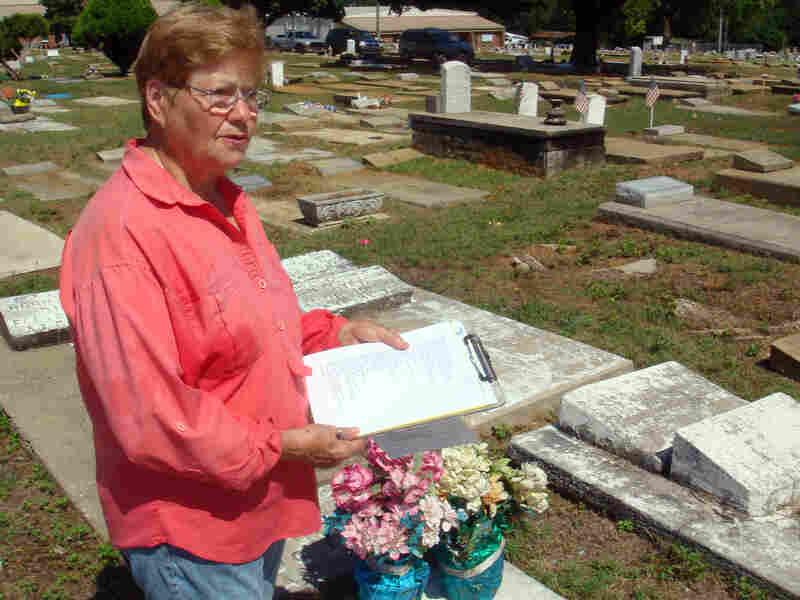 Phyllis Armstrong holds a list of graves she's trying to locate at Lincoln Cemetery.