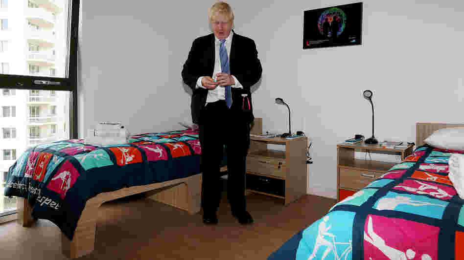 London Mayor Boris Johnson picks up a packet of Olympic branded condoms during a visit to the Olympic Village last month. Durex, the official Olympic supplier, has sent 150,000 condoms to the village. A bucket of rogue condoms has created a small controversy.