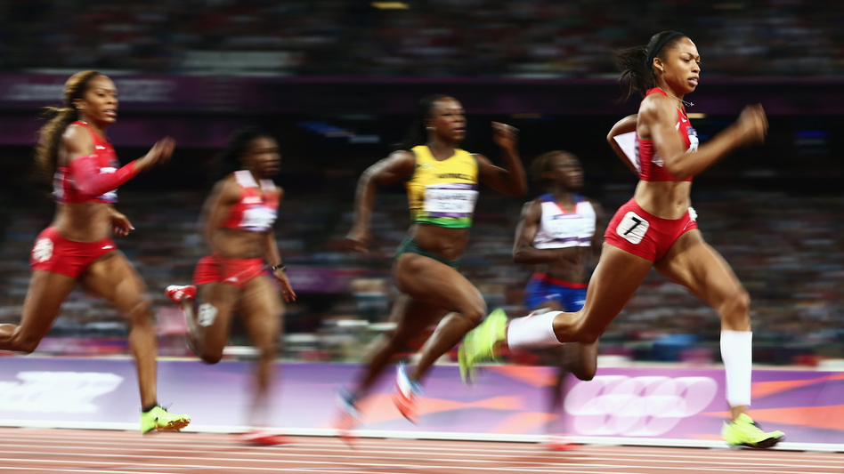 American sprinter Allyson Felix leads the field on her way to winning the women's 200 meters gold medal in London's Olympic Stadium.