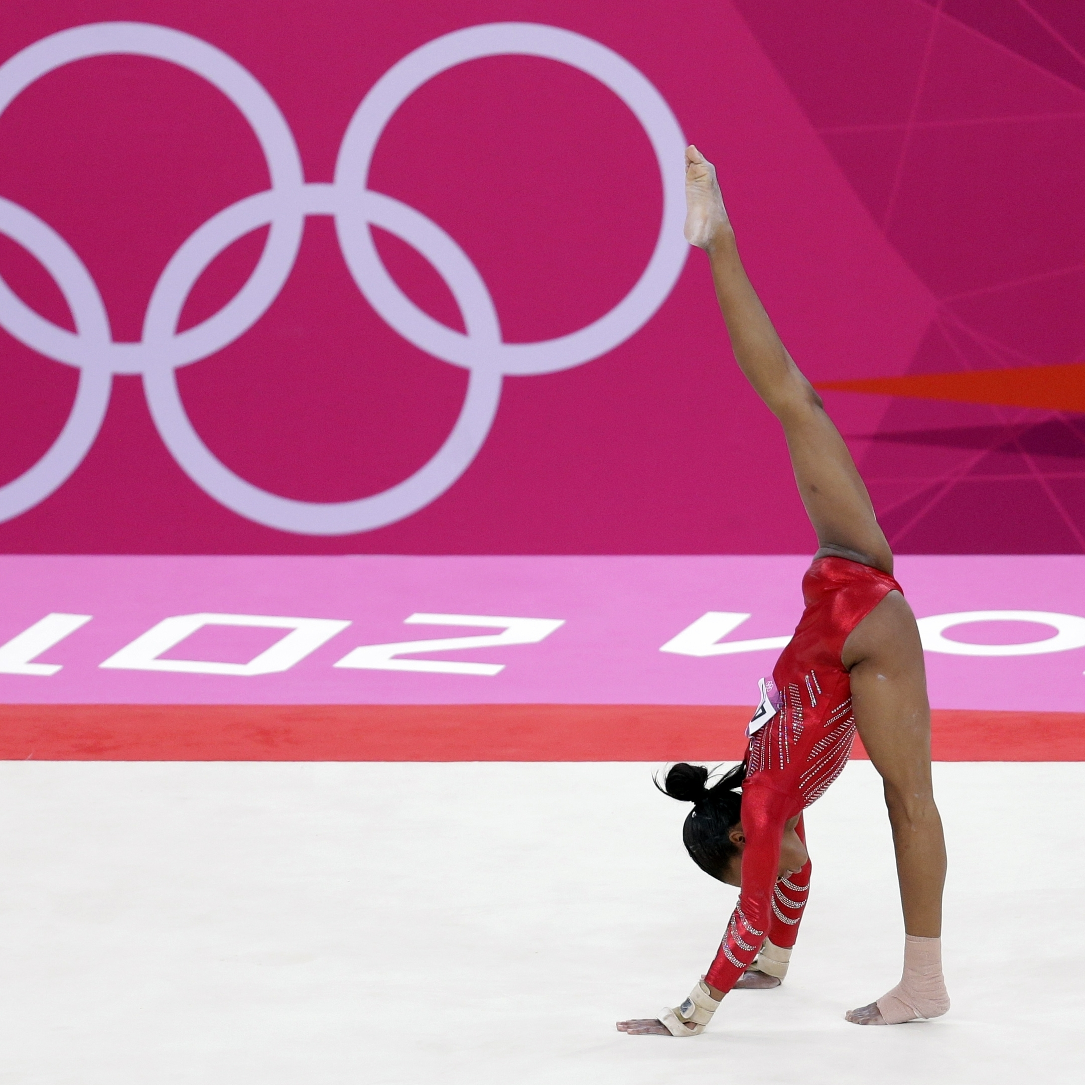 Gabrielle Douglas performs on the floor during the women's team final in London.