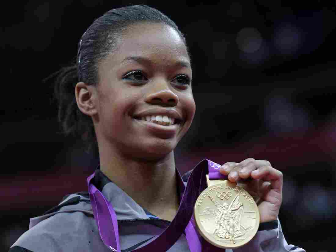 Gymnast Gabrielle Douglas, showing off her gold medal in the women's individual all-around competition last week.